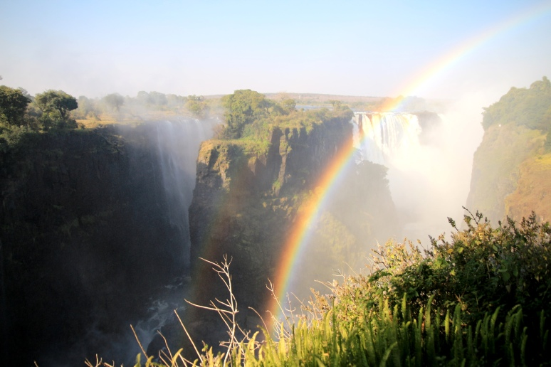 A beautiful view of the falls with the rainbow ...